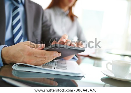 Close-up of businessman using touchpad at office - stock photo
