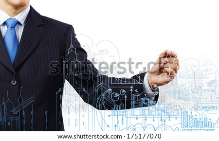 Close up of businessman with documents in hand drawing business sketches