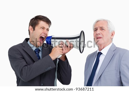 Close up of businessman with megaphone yelling at his boss against a white background
