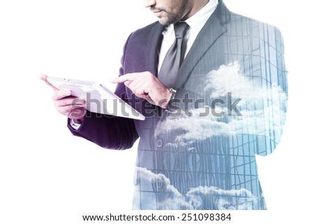 Close up of businessman with tablet double exposure isolated on white - stock photo