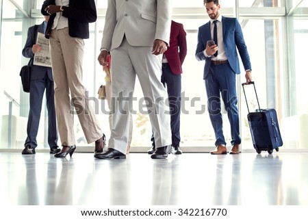 Close up of businessmen at airport - stock photo
