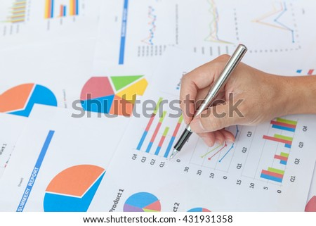 Close-up of businessmen working with financial document