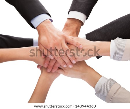 Close-up Of Businesspeople Hands Stacking Together Over White Background - stock photo