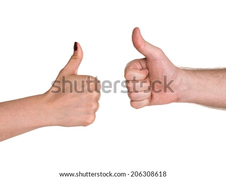 Close up of businesspeople's hand showing thumb up sign - stock photo