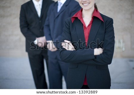 close up of businesspeople standing with arms crossed - stock photo