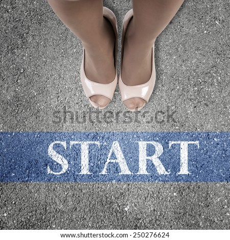 Close up of businesswoman feet standing at line - stock photo