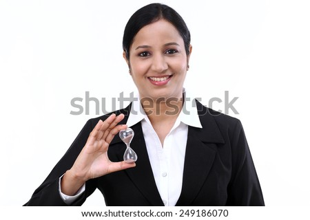 Close up of businesswoman hand holding hourglass - stock photo