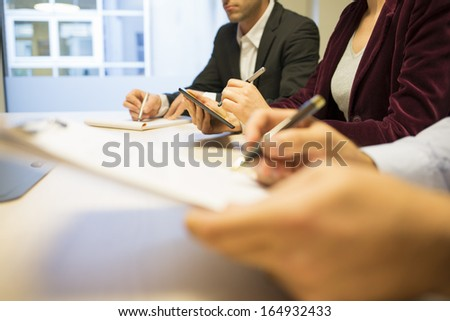 Close-up of Businesswoman hands working with stylus on tablet pc during a meeting