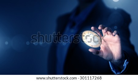 Close up of businesswoman holding in palms euro coin - stock photo