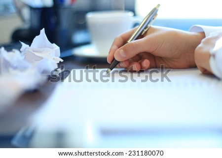 Close-up of Businesswoman makes a note at business document  - stock photo