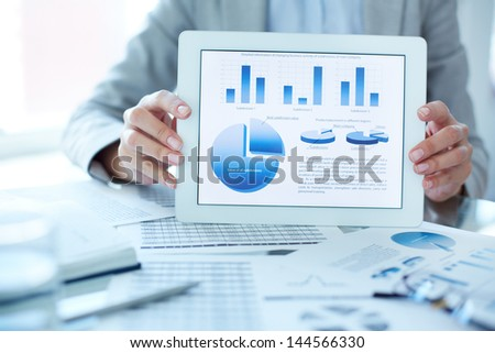 Close-up of businesswoman presenting financial situation in touchpad - stock photo