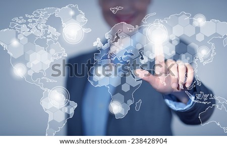 Close up of businesswoman touching media screen with finger - stock photo