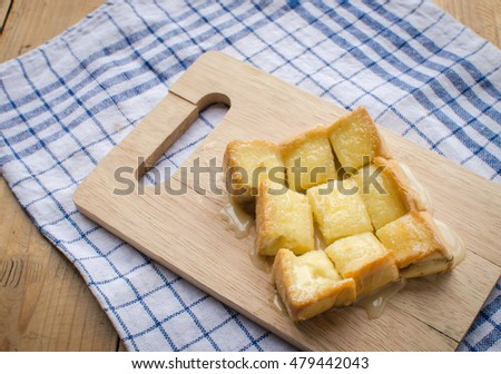 close up of butter milk toast on wooden board
