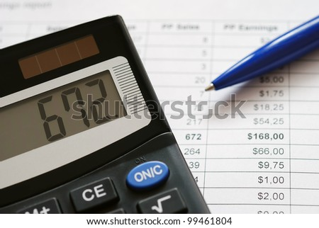 Close-up of calculator on financial documents - stock photo