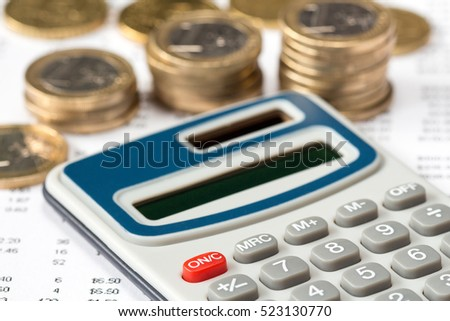 Close-up of calculator on financial statement with Euro coins, concept of accounts