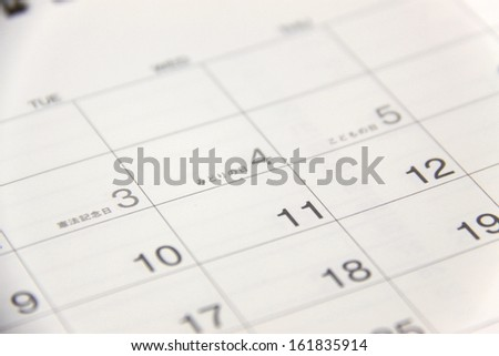 Close up of calendar page - stock photo