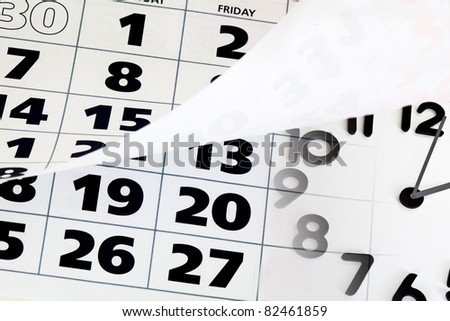Close up of calendar with wrapped page an the clock