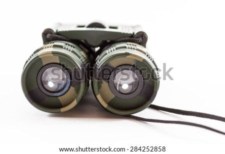 Close-up of camouflage style binoculars for modern day hunters and nature watchers - stock photo
