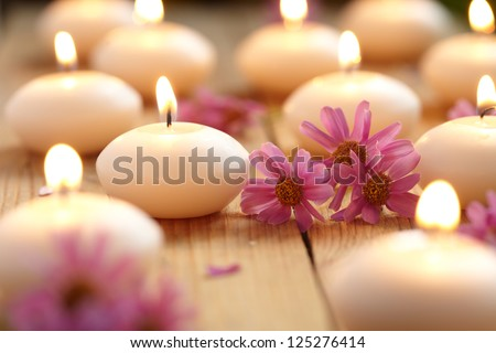 Close-up of candles and flowers - stock photo