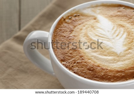 close up of cappuccino with latte art, shallow dof