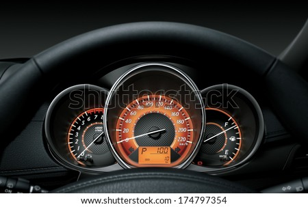 Close up of car dashboard and Odometer. - stock photo