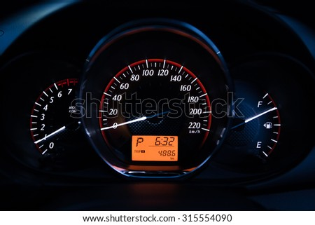 Close up of car dashboard and Trip Odometer. - stock photo