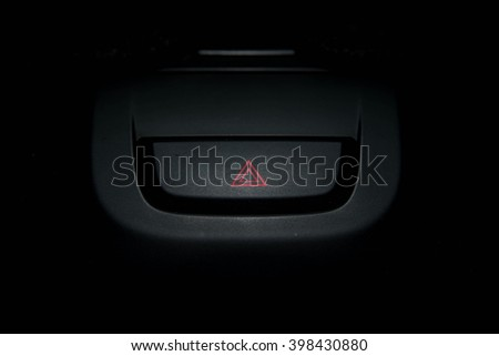 Close up of car emergency button - warning button in a car. - stock photo