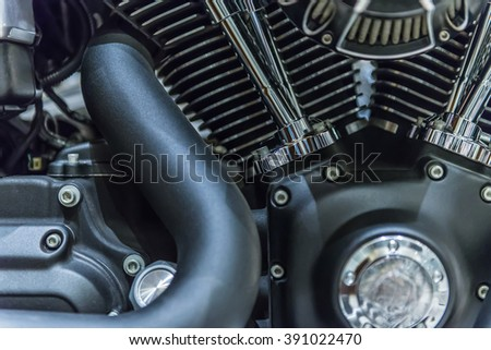 close up of Car Engine with metal, chrome, steel, plastic parts.