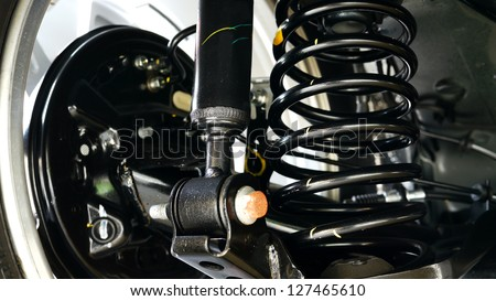 Close Up of Car Shock Absorber and Spring. - stock photo