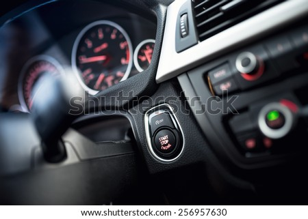 close-up of car start and stop button. Modern car interior with dashboard and cockpit details - stock photo