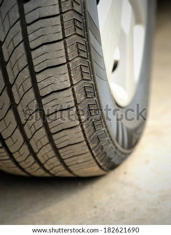 Close up of car tire, selective focus. - stock photo