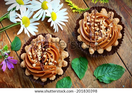 Close up of caramel shortbread cupcakes with nuts