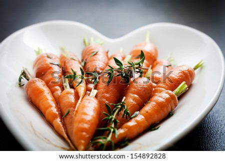 Close up of carrots with fresh thyme  - stock photo