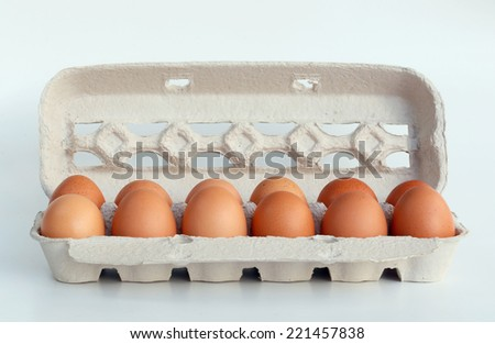 close up of carton box with brown chicken eggs - stock photo