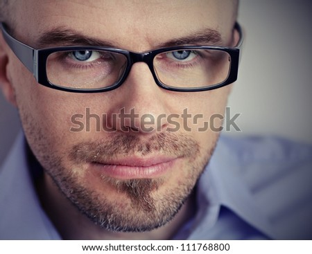 Close up of caucasian male wearing spectacles in smart cloths