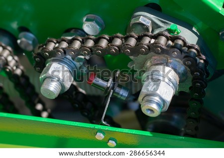 Close up of chain on gear on agricultural machine
