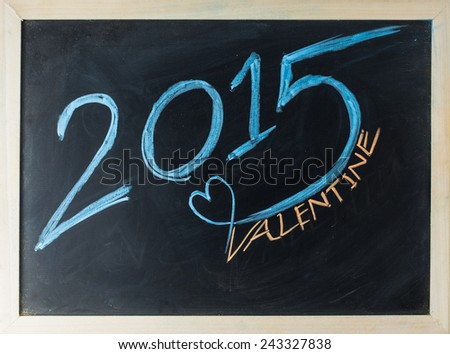 close up of chalkboard 2015 and valentine topic - stock photo