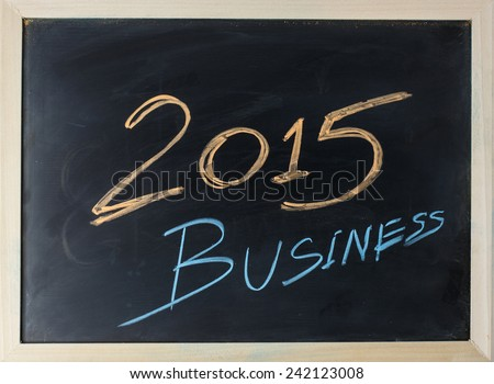 close up of chalkboard with finance business 2015 - stock photo