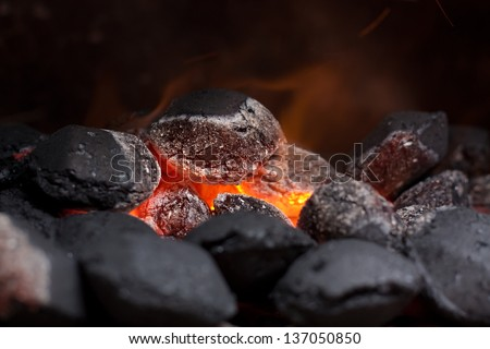 Close up of charcoal briquettes ready for barbecue grill. - stock photo