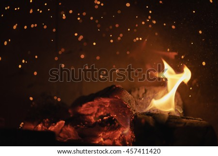 close up of charcoal burning in fireplace - stock photo