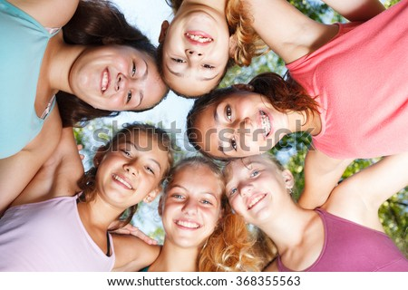 Close-up of cheerful teenage girls