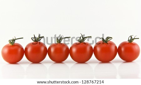 Close Up of cherry tomatoes on the vine . - stock photo