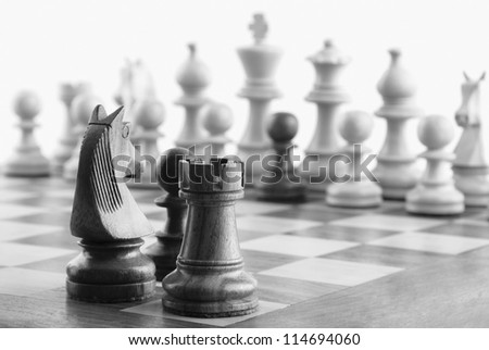 Close-up of chess pieces on a chessboard - stock photo