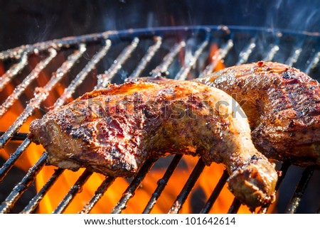Close-up of chicken leg on the grill