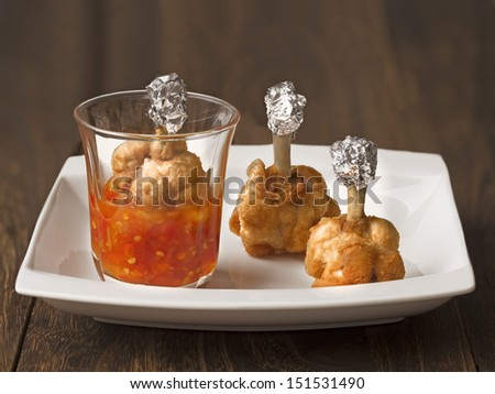 close up of chicken lollipops - stock photo