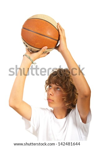 Close up of child throwing basketball isolated on white background - stock photo