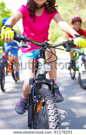 Close-up of children?s bike ridden by a girl - stock photo