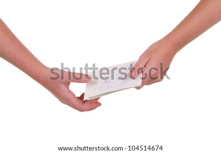 Close-up of childrens hands passing a note - stock photo