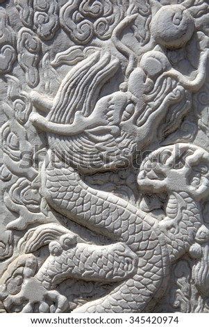 Close up of Chinese dragon carving - stock photo