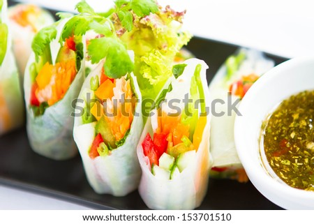 Close up of Chinese spring rolls (popia) isolated on white background. - stock photo